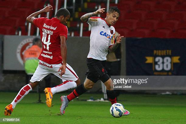 Ernando of Internacional battles for the ball against Paolo Guerrero of Flamengo during the match between Internacional and Flamengo as part of...