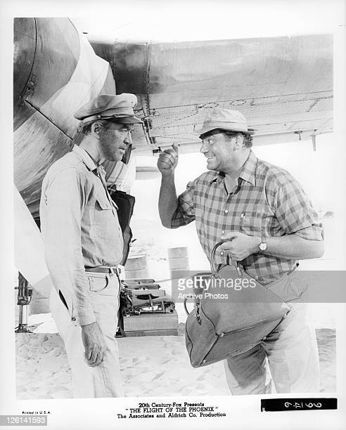 Ernest Borgnine insists to James Stewart that he can walk out of desert in a scene from the film 'The Flight Of The Phoenix' 1965
