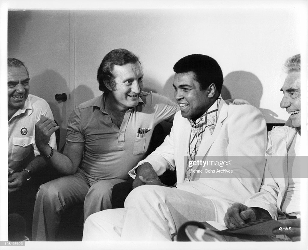 Ernest Borgnine, John Marshall (producer), Muhammad Ali and John Marley have a laugh between takes in a publicity still from the film 'The Greatest', 1977.