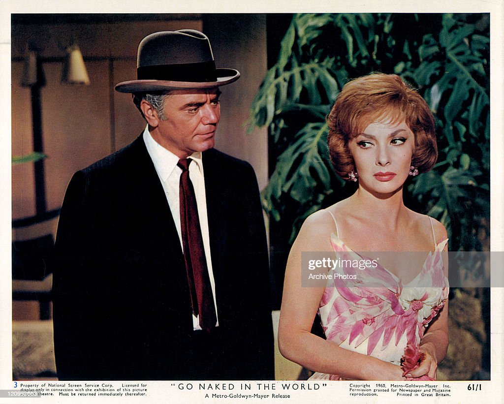 Ernest Borgnine stands on the side of Gina Lollobrigida in a scene from the film 'Go Naked In The World', 1961.