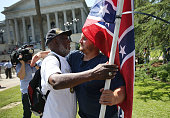 Ernest Branch hugs a man carrying a Confederate flag saying that he respects the fact the guy likes the flag but that he is against the flag flying...