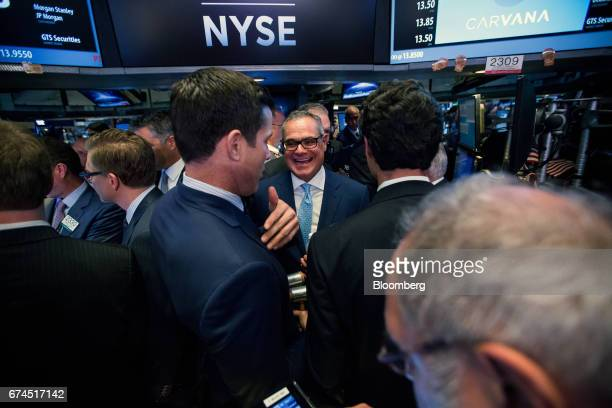 Ernest Garcia II chairman of Carvana Co center laughs during the company's initial public offering on the floor of the New York Stock Exchange during...