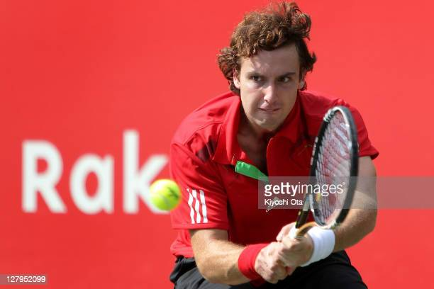 Ernest Gulbis of Latvia hits a backhand in his first round match against Lukasz Kubot of Poland during day two of the Rakuten Open at Ariake...