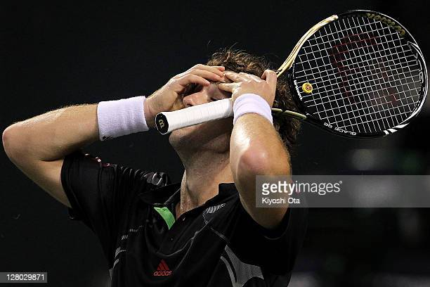Ernest Gulbis of Latvia holds his head after losing a point in his second round match against Mardy Fish of the United States during day three of the...
