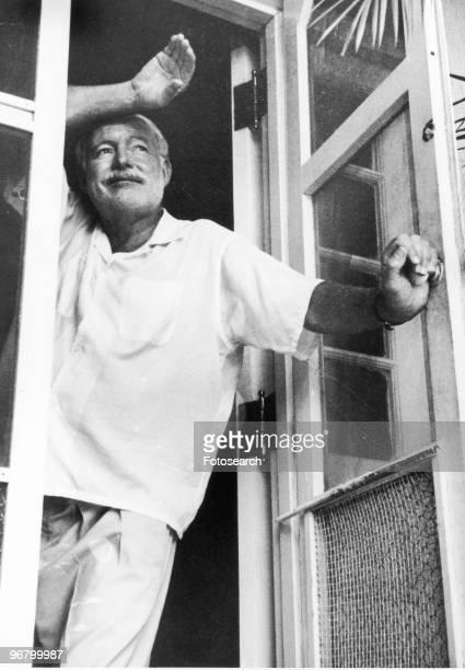 Ernest Hemingway standing looking out of doors circa 1960s