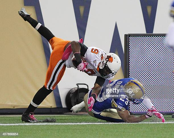 Ernest Jackson of the BC Lions gets pushed out by Desia Dunn of the Winnipeg Blue Bombers after scoring a touchdown in second half action in a CFL...