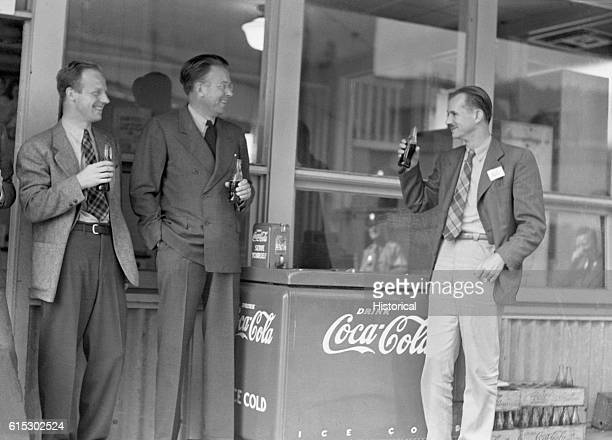 Ernest Lawrence second from right and Arthur Compton enjoy a cold Coca Cola