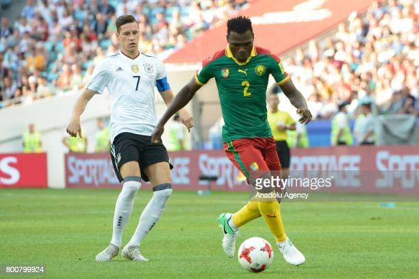 Ernest Mabouka of Cameroon in action against Julian Draxler of Germany during the FIFA Confederations Cup 2017 soccer match between Cameroon and...