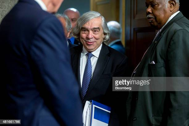 Ernest Moniz US secretary of energy center arrives to a Senate Foreign Relations Committee hearing in Washington DC US on Thursday July 23 2015...