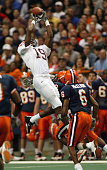 Ernest Wilford of Virginia Tech makes one of his eight catches as Clifton Smith Maurice Mcclain and Will Hunter of Syracuse try to defend at the...