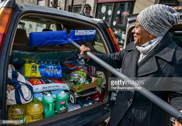 Ernestine Tyus puts the last item on her list a snow shovel into the back of her van after loading up on supplies ahead of a potentially historic...