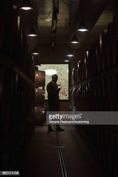 Ernesto Abbona the owner of Marchesi di Barolo winery taste a glass of Barolo on October 17 2017 in the Barolo region Italy Because of the high...
