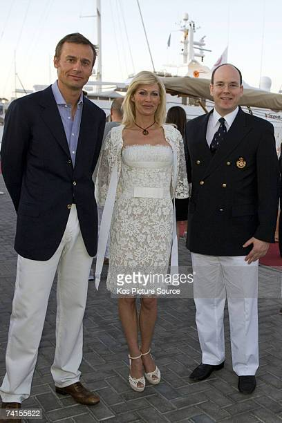 Ernesto Bertarelli head of Alinghi with his wife Kirsten meets Prince Albert II of Monaco during the Louis Vuitton Cup The winner of the Louis...