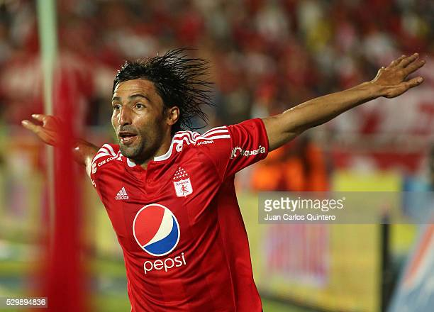 Ernesto Farias of America celebrates after scoring the opening goal during a match between America de Cali and Real Cartagena as part of round 13 of...