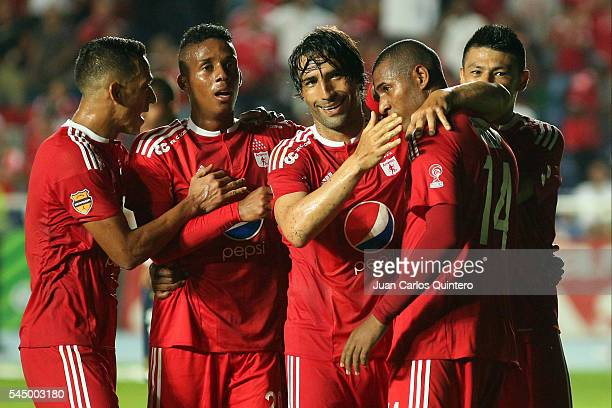 Ernesto Farias of America de Cali celebrates with teammates after scoring the second goal of his team during a match between Atletico FC and America...