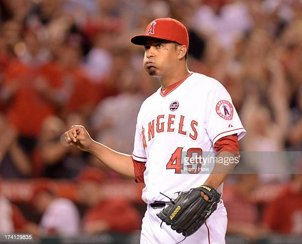 Ernesto Frieri of the Los Angeles Angels celebrates a save and a 20 win over the Oakland Athletics at Angel Stadium of Anaheim on July 20 2013 in...