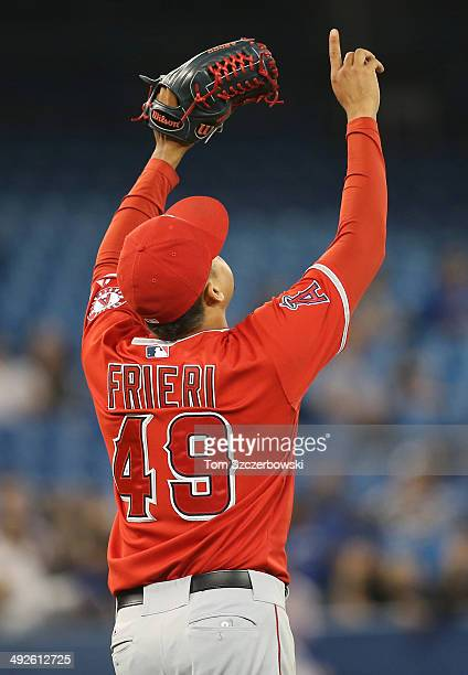 Ernesto Frieri of the Los Angeles Angels of Anaheim celebrates his save and the team's victory during MLB game action against the Toronto Blue Jays...