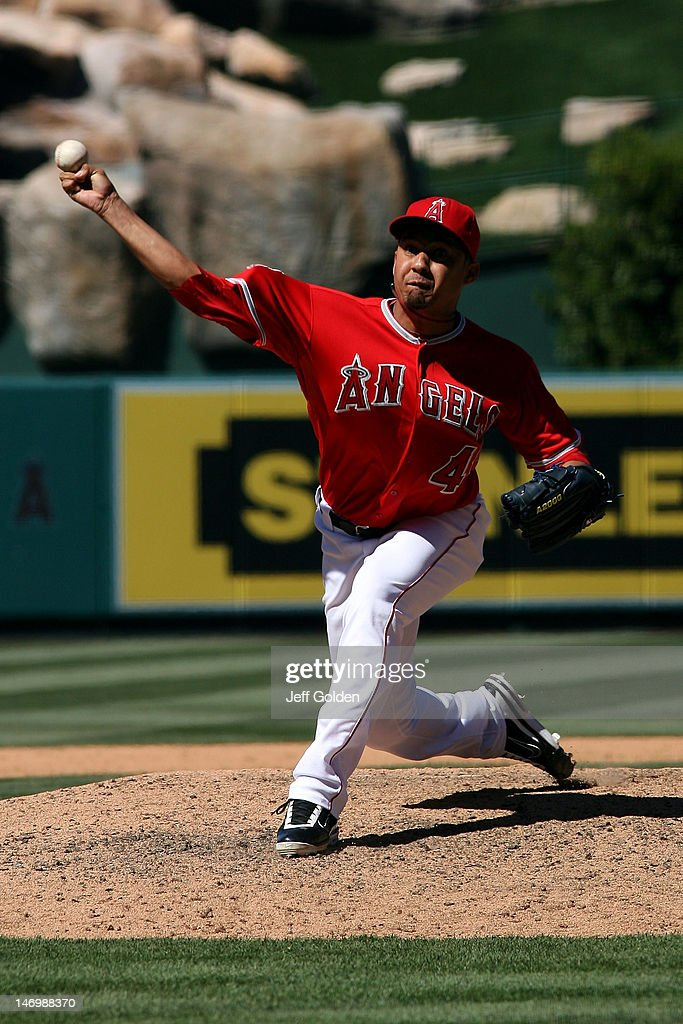 Ernesto Frieri #49 of the Los Angeles Angels of Anaheim pitches against the Los Angeles Dodgers in the eighth inning of the interleague game at Angel Stadium of Anaheim on June 24, 2012 in Anaheim, California.