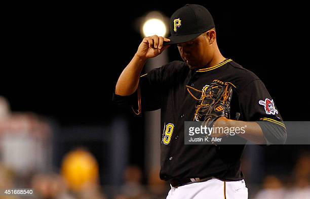 Ernesto Frieri of the Pittsburgh Pirates reacts after giving up five hit and five runs in the ninth inning against the Arizona Diamondbacks during...