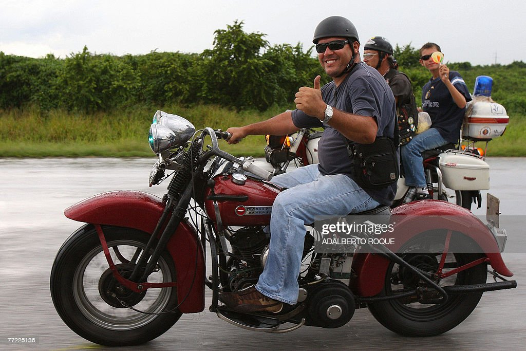 Ernesto Guevara March, the youngest son of revolutionary leader Ernesto Che Guevara, gives his thumb up as he joins a group of Harley Davidson fanatics in a peregrination from Havana to the mausoleum of his father in the Cuban eastern town of Santa Clara, on October 8th, 2007, on the 40th anniversary of the revolutionary's death. For decades a global symbol of rebellion, Ernesto 'Che' Guevara is to be honored today with ceremonies in Cuba, where his myth was forged, and Bolivia, where he was executed 40 years ago spreading the gospel of Marxist revolution.