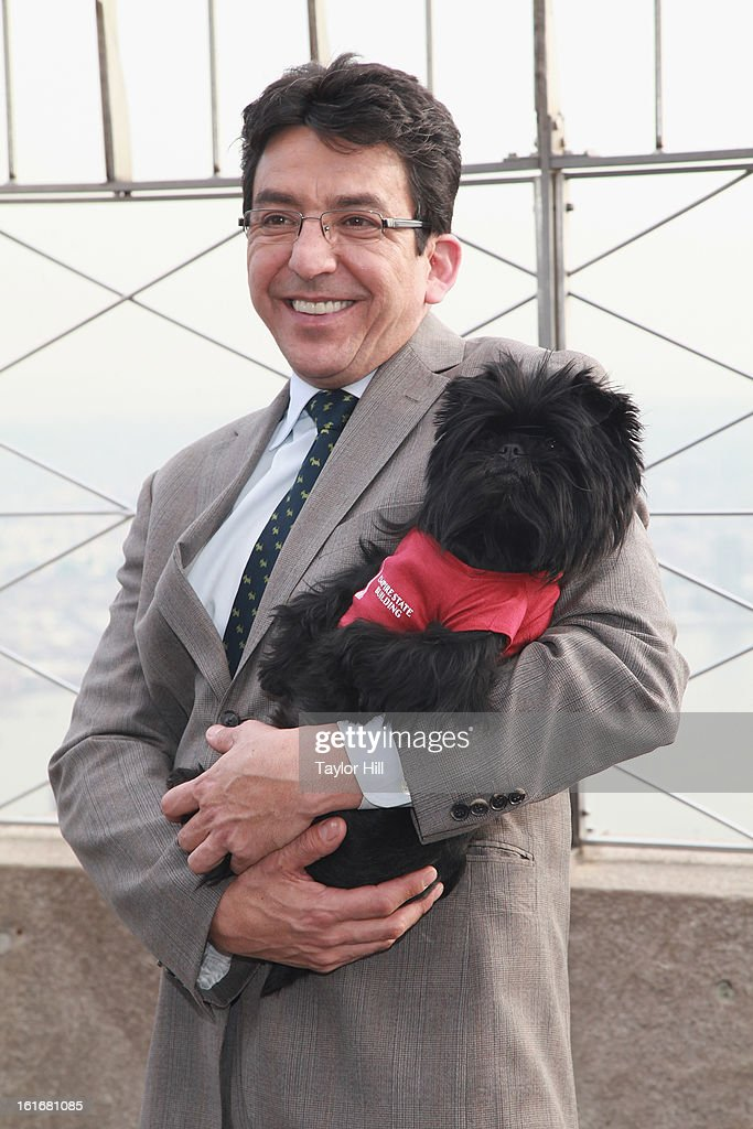 Ernesto Lara and Westminster Kennel Club Best in Show Affenpinscher Banana Joe visits The Empire State Building on February 13, 2013 in New York City.