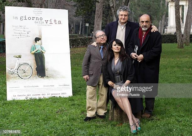 Ernesto Mahieux Giuseppe Papasso Maria Grazia Cucinotta Giorgio Haber attend the 'Un Giorno della Vita' photocall at La Casa Del Cinema on January 11...