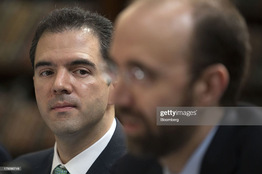 Ernesto Revilla, chief economist for the Mexican finance ministry, left, listens to Rodrigo Barros, head of tax revenue policy at the finance ministry, speak at a news conference in Mexico City, Mexico, on Wednesday, July 31, 2013. Revilla said Mexico will have a solid economic recovery in the second half of 2013. Photographer: Susana Gonzalez/Bloomberg via Getty Images