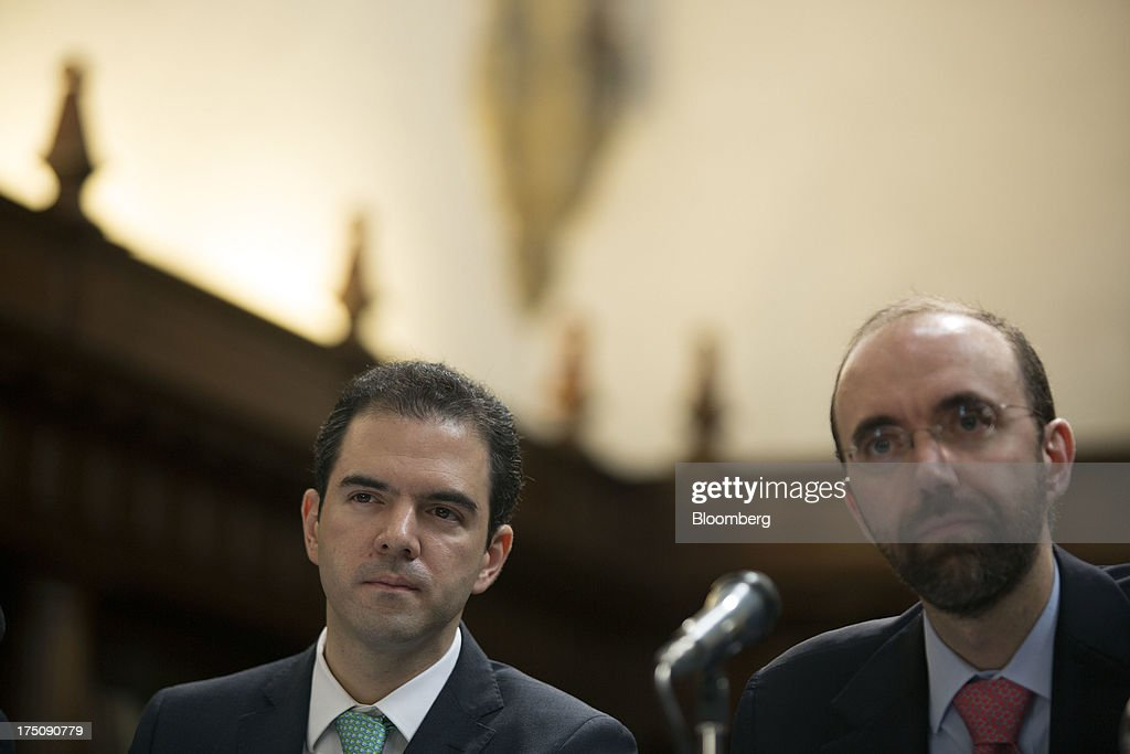 Ernesto Revilla, chief economist for the Mexican finance ministry, left, and Rodrigo Barros, head of tax revenue policy at the finance ministry, listen to a question at a news conference in Mexico City, Mexico, on Wednesday, July 31, 2013. Revilla said Mexico will have a solid economic recovery in the second half of 2013. Photographer: Susana Gonzalez/Bloomberg via Getty Images