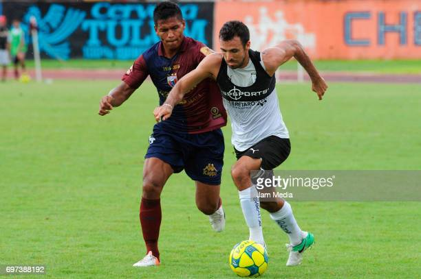 Ernesto Reyes Cruz of Atlante and Jonathan Borstein of Queretaro fight for the ball during the Pre Season training match for the Torneo Apertura 2017...