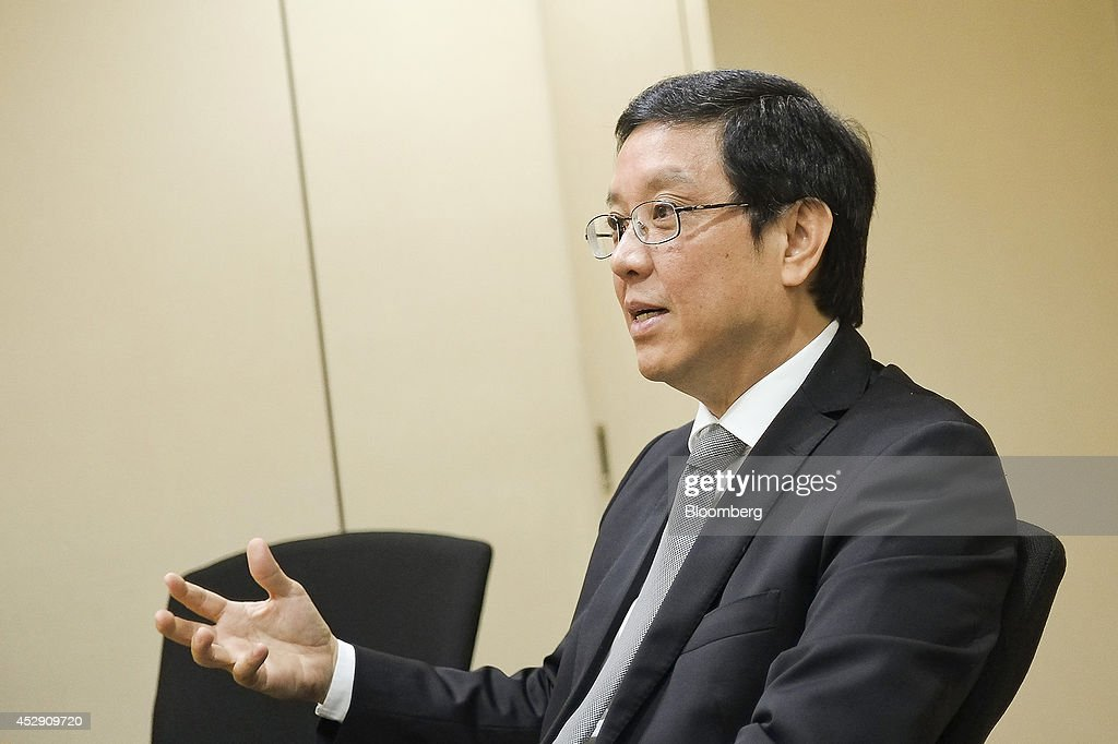 Ernesto Tanmantiong, chief executive officer of Jollibee Foods Corp., speaks during an interview in Pasig City, Metro Manila, the Philippines, on Monday, July 28, 2014. Jollibee, which outsells McDonald's Corp. in the Philippines, plans to double earnings in five years as it accelerates its expansion in China and seeks an acquisition in the U.S. Photographer: Veejay Villafranca/Bloomberg via Getty Images