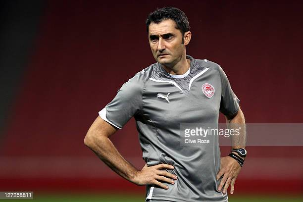 Ernesto Valverde of Olympiacos FC looks on during a training session prior to the UEFA Champions League Group match against Arsenal at the Emirates...