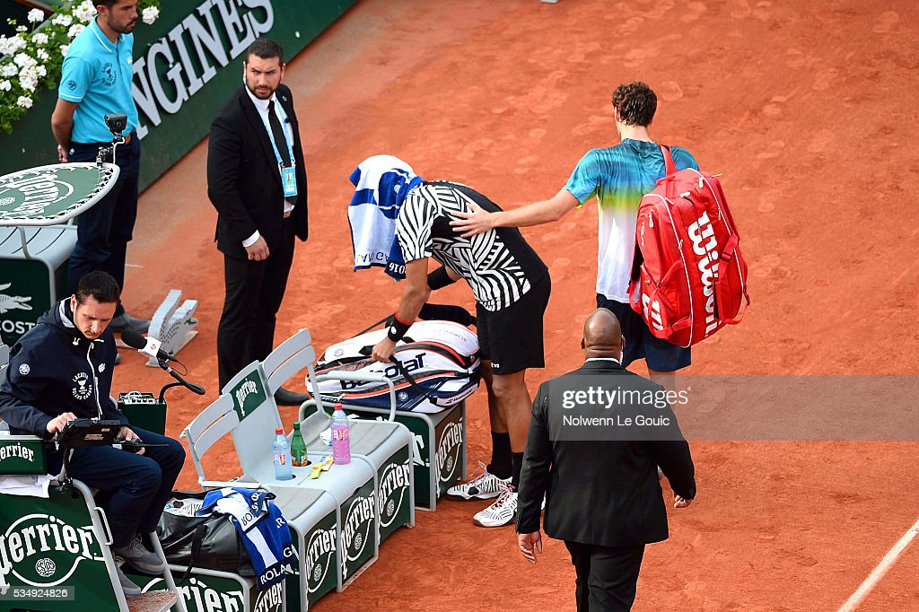 Ernests Gulbis and Jo Wilfried Tsonga who retires from the match due to injury during the Men's Singles third round on day seven of the French Open 2016 on May 28, 2016 in Paris, France.