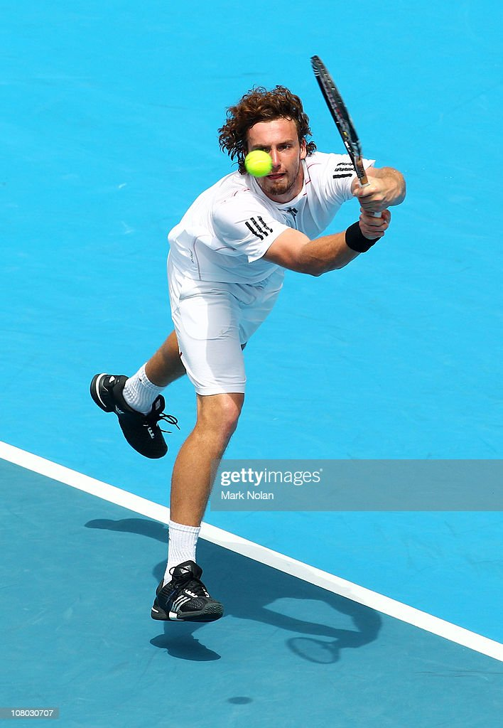 <a gi-track='captionPersonalityLinkClicked' href=/galleries/search?phrase=Ernests+Gulbis&family=editorial&specificpeople=4095282 ng-click='$event.stopPropagation()'>Ernests Gulbis</a> of Lativa hits a backhand in his semi final match aginst Gilles Simon of France during day six of the 2011 Medibank International at Sydney Olympic Park Tennis Centre on January 14, 2011 in Sydney, Australia.