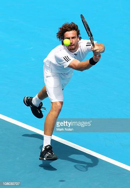 Ernests Gulbis of Lativa hits a backhand in his semi final match aginst Gilles Simon of France during day six of the 2011 Medibank International at...