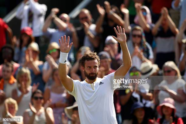 Ernests Gulbis of Latvia acknowledges the crowd as he celebrates victory after his Gentlemen's Singles second round match against Juan Martin Del...