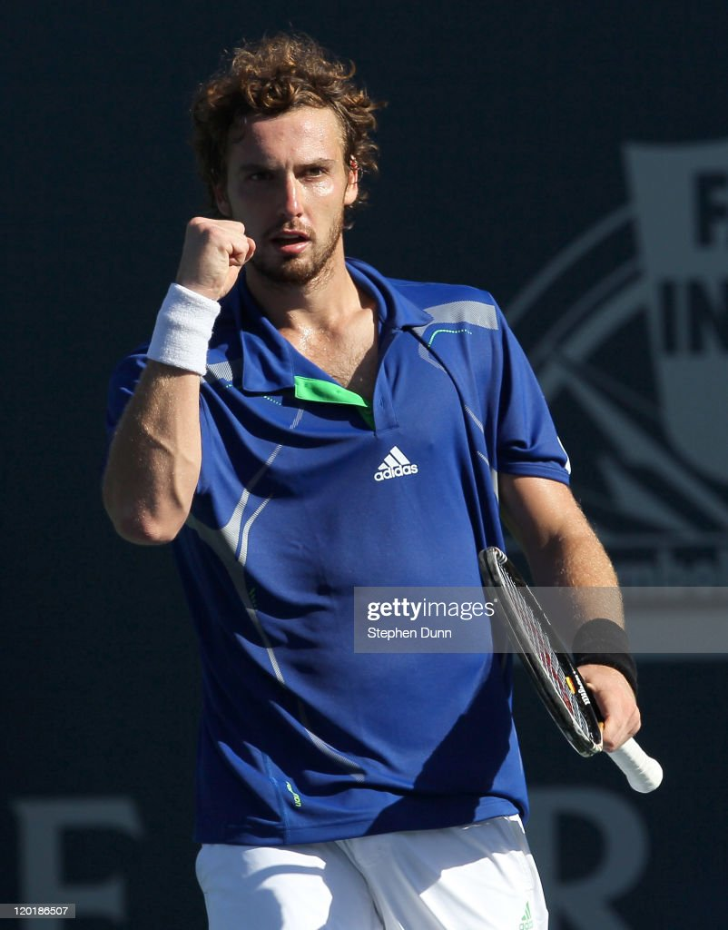 <a gi-track='captionPersonalityLinkClicked' href=/galleries/search?phrase=Ernests+Gulbis&family=editorial&specificpeople=4095282 ng-click='$event.stopPropagation()'>Ernests Gulbis</a> of Latvia celebrates after winning match point against Mardy Fish in the singles final of the Farmers Classic presented by Mercedes-Benz at the LA Tennis Center on July 31, 2011 in Los Angeles, California. Gulbis won 5-7, -4, 6-4.