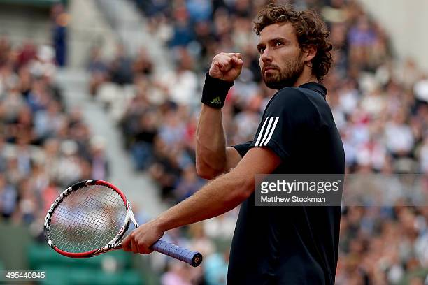 Ernests Gulbis of Latvia celebrates victory in his men's singles quarterfinal match against Tomas Berdych of Czech Republic on day ten of the French...