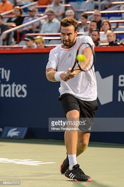 Ernests Gulbis of Latvia hits a return against Novak Djokovic of Serbia during day five of the Rogers Cup at Uniprix Stadium on August 14 2015 in...