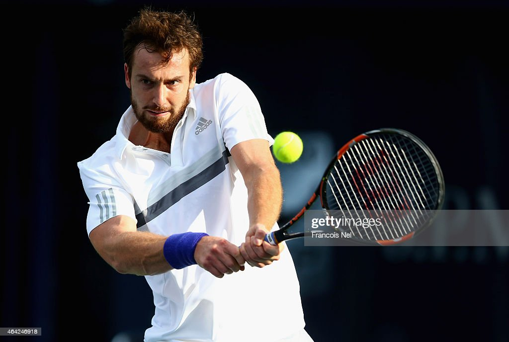 <a gi-track='captionPersonalityLinkClicked' href=/galleries/search?phrase=Ernests+Gulbis&family=editorial&specificpeople=4095282 ng-click='$event.stopPropagation()'>Ernests Gulbis</a> of Latvia in action against Denis Istomin of Uzbekistan during day one of the ATP Dubai Duty Free Tennis Championships at the Dubai Duty Free Stadium on February 23, 2015 in Dubai, United Arab Emirates.