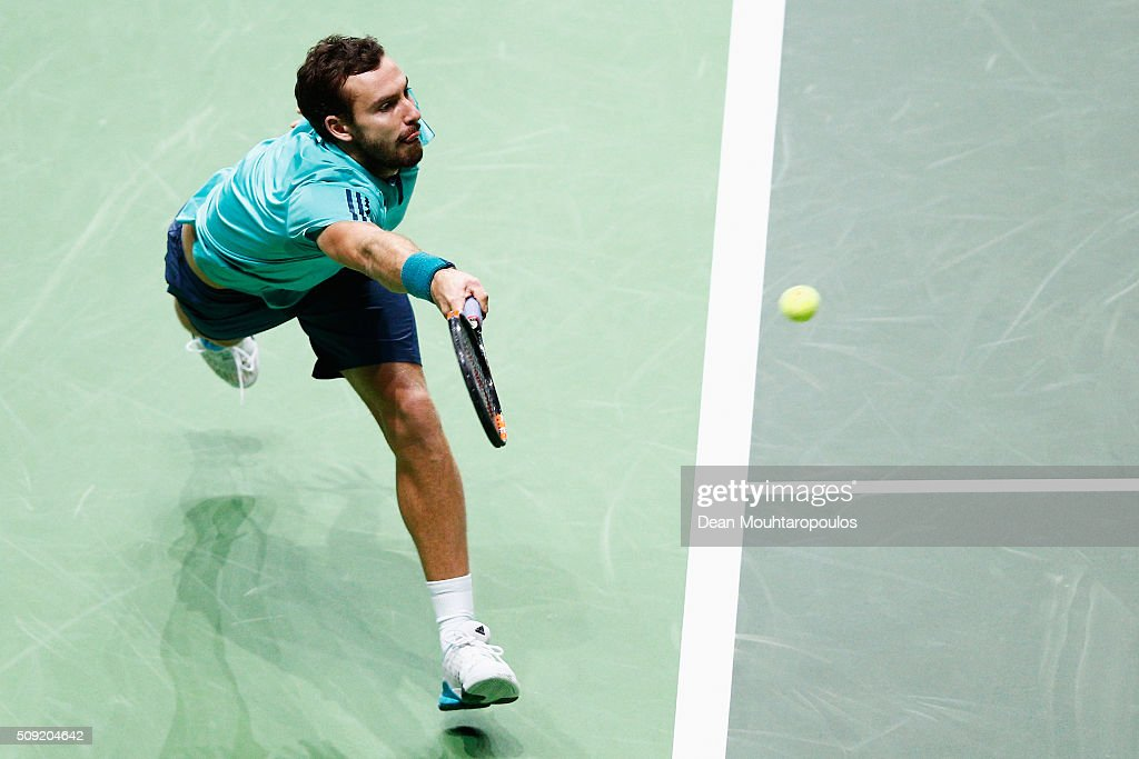 <a gi-track='captionPersonalityLinkClicked' href=/galleries/search?phrase=Ernests+Gulbis&family=editorial&specificpeople=4095282 ng-click='$event.stopPropagation()'>Ernests Gulbis</a> of Latvia in action against Gael Monfils of France during day 2 of the ABN AMRO World Tennis Tournament held at Ahoy Rotterdam on February 9, 2016 in Rotterdam, Netherlands.
