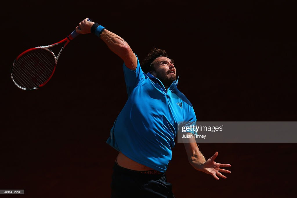 <a gi-track='captionPersonalityLinkClicked' href=/galleries/search?phrase=Ernests+Gulbis&family=editorial&specificpeople=4095282 ng-click='$event.stopPropagation()'>Ernests Gulbis</a> of Latvia in action against Jerzy Janowicz of Poland during day four of the Mutua Madrid Open tennis tournament at the Caja Magica on May 6, 2014 in Madrid, Spain.