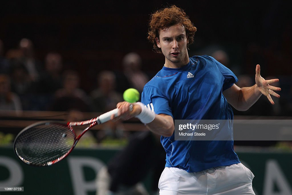 <a gi-track='captionPersonalityLinkClicked' href=/galleries/search?phrase=Ernests+Gulbis&family=editorial&specificpeople=4095282 ng-click='$event.stopPropagation()'>Ernests Gulbis</a> of Latvia in action during his match against Juan Ignacio Chela of during Day One of the ATP Masters Series Paris at the Palais Omnisports on November 7, 2010 in Paris, France.