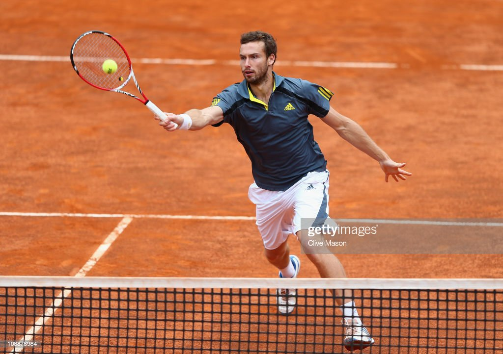 <a gi-track='captionPersonalityLinkClicked' href=/galleries/search?phrase=Ernests+Gulbis&family=editorial&specificpeople=4095282 ng-click='$event.stopPropagation()'>Ernests Gulbis</a> of Latvia in action during his third round match against Rafael Nadal of Spain on day five of the Internazionali BNL d'Italia 2013 at the Foro Italico Tennis Centre on May 16, 2013 in Rome, Italy.