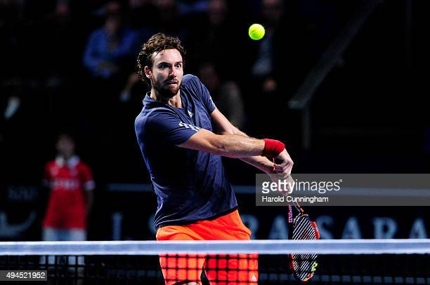 Ernests Gulbis of Latvia in action during the second day of the Swiss Indoors ATP 500 tennis tournament against John Isner of US at St Jakobshalle on...