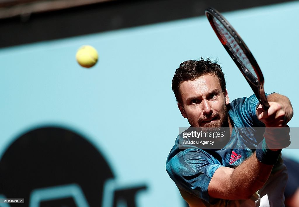 Ernests Gulbis of Latvia in an action against Lucas Pouille of France during a men's singles match at the Mutua Madrid Open tennis tournament at the Caja Magica in Madrid, Spain on April 30, 2016.