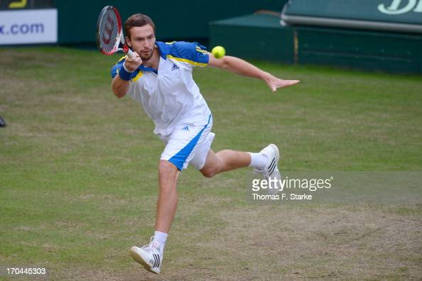 Ernests Gulbis of Latvia plays a forehand in his match against Tommy Haas of Germany during day four of the Gerry Weber Open at Gerry Weber Stadium...