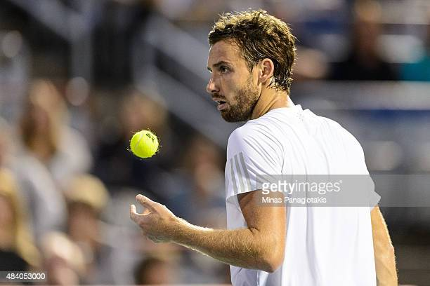 Ernests Gulbis of Latvia prepares to serve against Novak Djokovic of Serbia during day five of the Rogers Cup at Uniprix Stadium on August 14 2015 in...