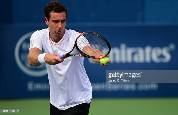 Ernests Gulbis of Latvia prepares to serve to Lukas Rosol of Czech Republic during the first day of the WinstonSalem Open at Wake Forest University...