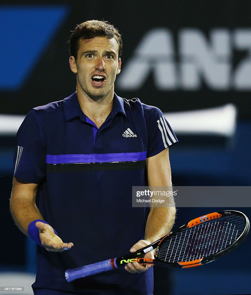 <a gi-track='captionPersonalityLinkClicked' href=/galleries/search?phrase=Ernests+Gulbis&family=editorial&specificpeople=4095282 ng-click='$event.stopPropagation()'>Ernests Gulbis</a> of Latvia reacts after losing a point in his first round match against Thanasi Kokkinakis of Australia during day one of the 2015 Australian Open at Melbourne Park on January 19, 2015 in Melbourne, Australia.