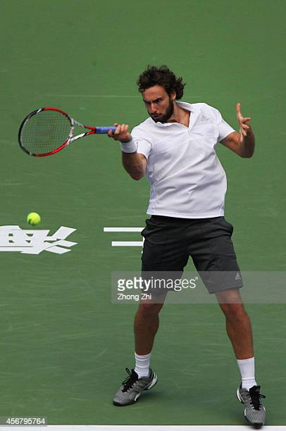Ernests Gulbis of Latvia returns a shot during his match against Mikhail Youzhny of Russia during the day 3 of the Shanghai Rolex Masters at the Qi...